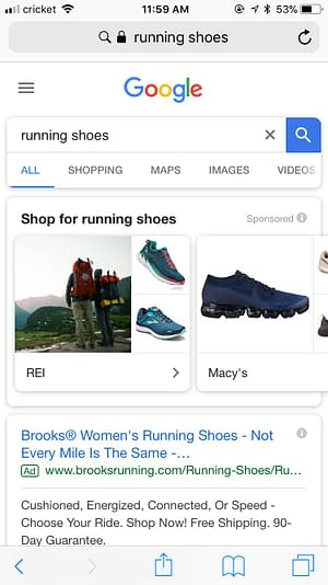 Google search of running shoes displaying shopping showcase ads
