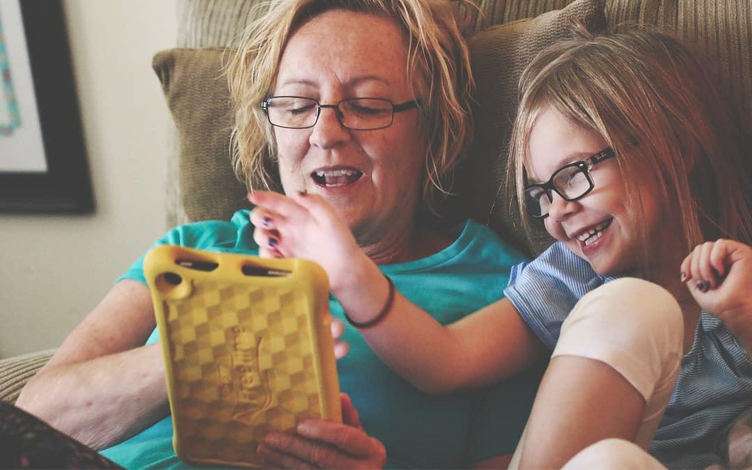 mom and daughter watching ott video