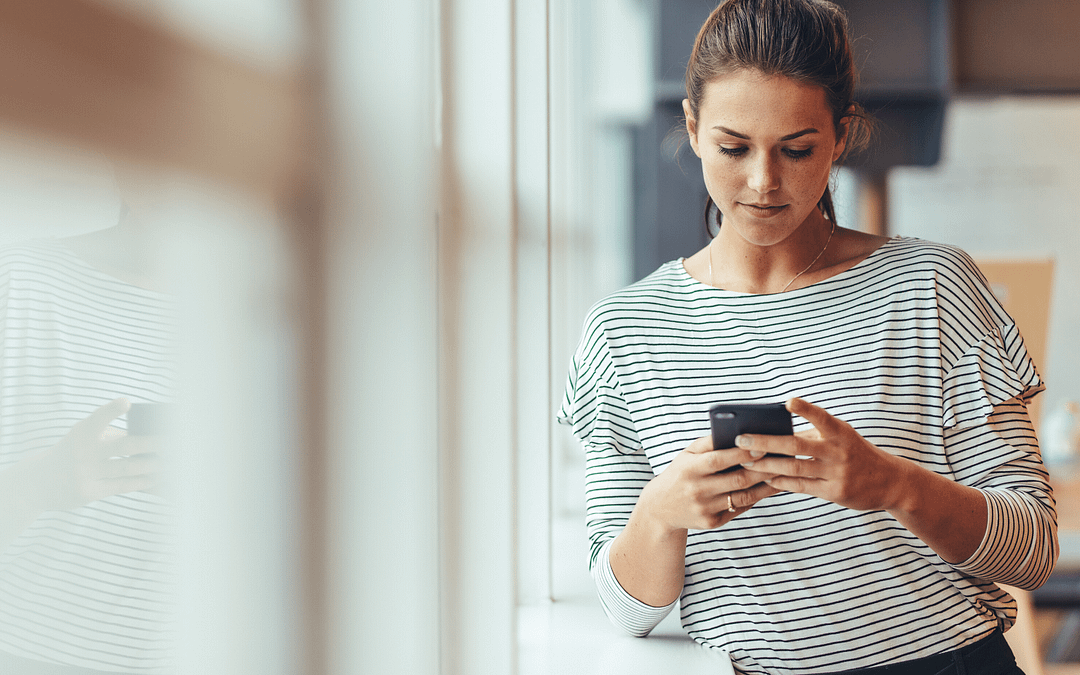 consumer interacting with google app campaigns on her mobile phone